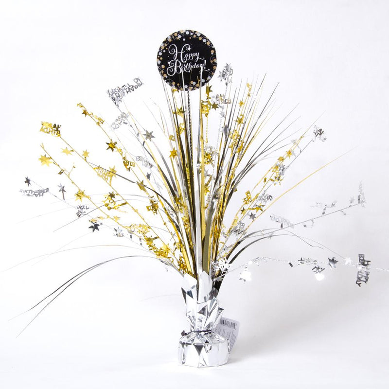 A stylish party centrepiece spray with gold and silver foil tassels and a