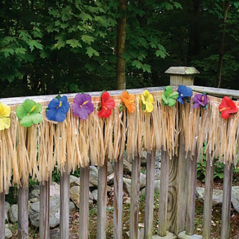 A wooden garden deck with a colourful Hawaiian-styled Luau fringe