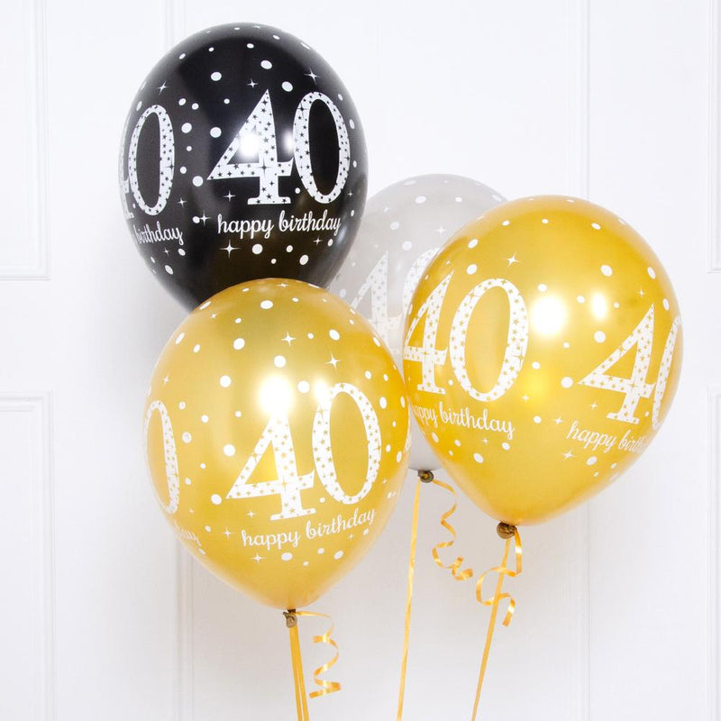 A bunch of 40th birthday latex balloons in gold, silver, and black colours