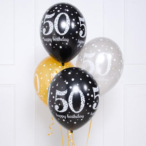 A bunch of 50th birthday balloons in gold, silver, and black styles
