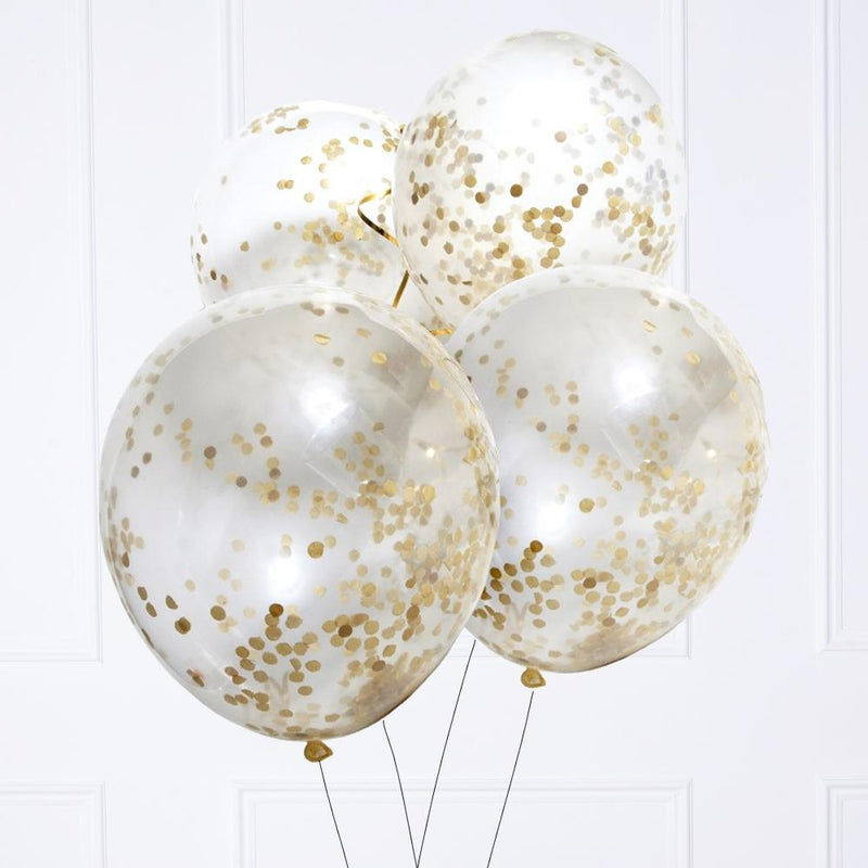 A bunch of clear latex party balloons filled with glimmery gold confetti dots