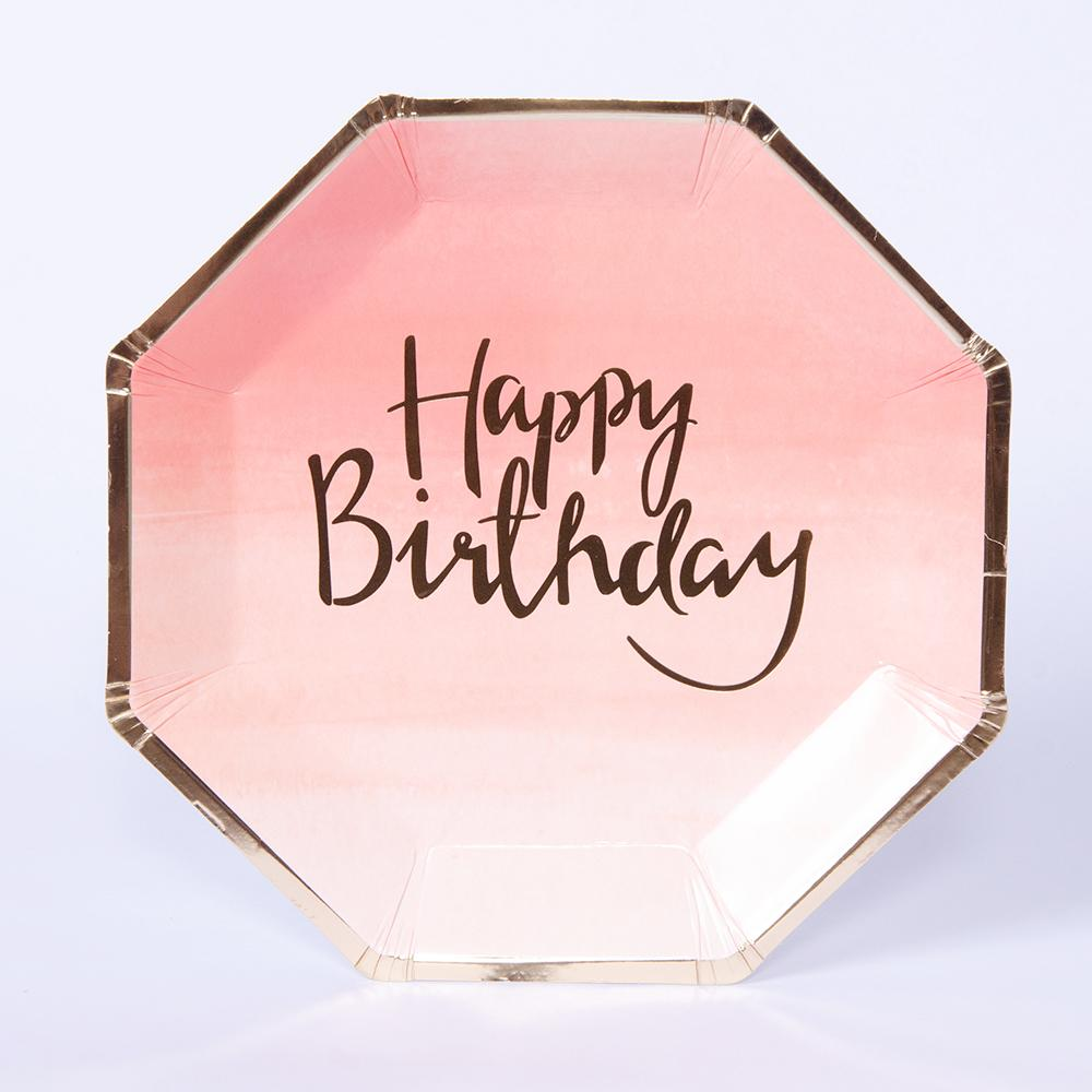 "A pink pastel-coloured octagonal party plate with a gold foil ""Happy Birthday"" phrase"