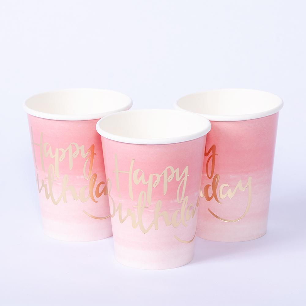 "A set of 3 pastel pink party cups with a ""Happy Birthday!"" phrase written in gold foil cursive text"