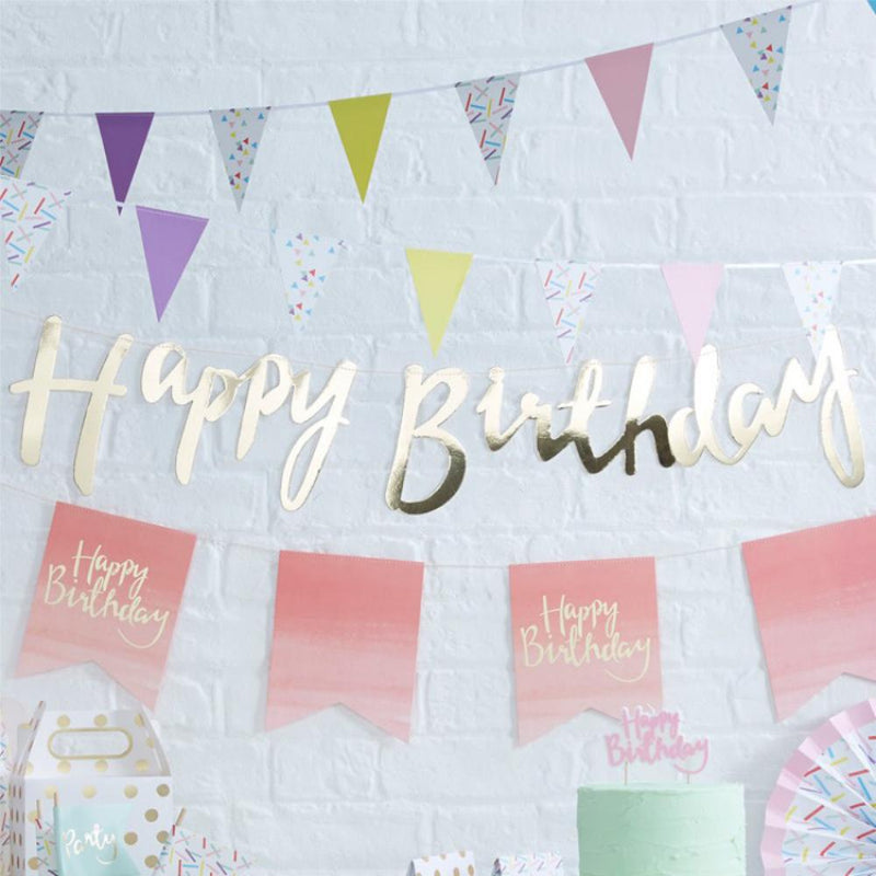 "A gold foil ""Happy Birthday"" party bunting"