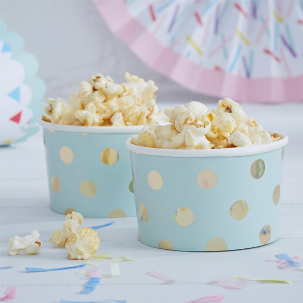 2 mint green paper party treat tubs filled with popcorn