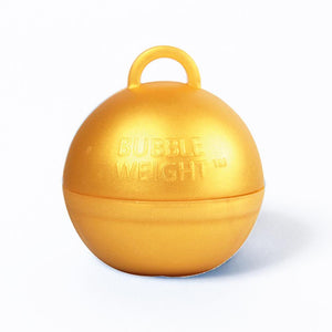 A round, gold-coloured balloon weight