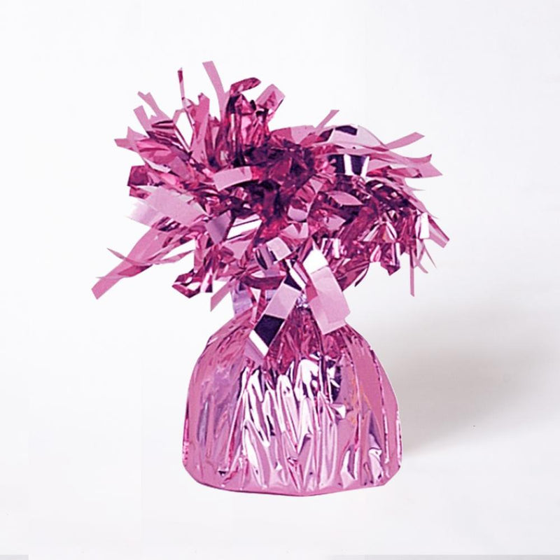 A pink foil balloon weight with fluttery tassels on top