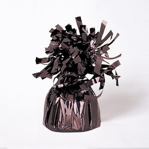 A black foil balloon weight with fluttery tassels on top