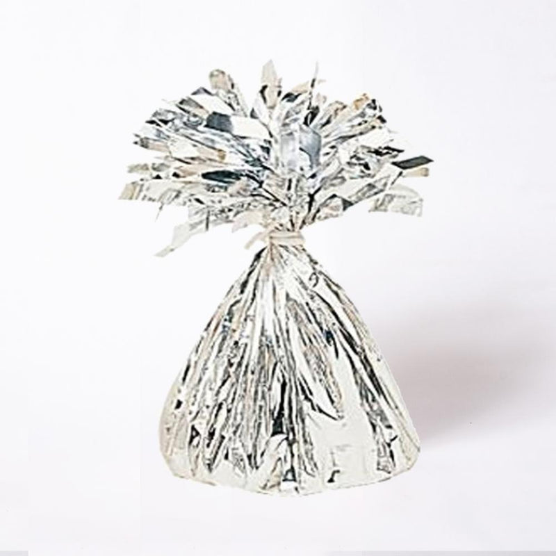 A silver foil balloon weight with fluttery tassels on top