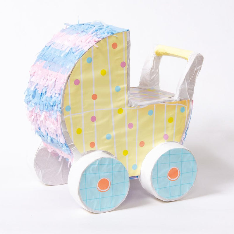 A baby carriage-shaped pinata with pink and blue paper decorations