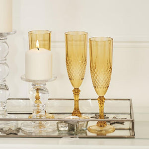 3 gold plastic champagne glasses with a vintage-styled design