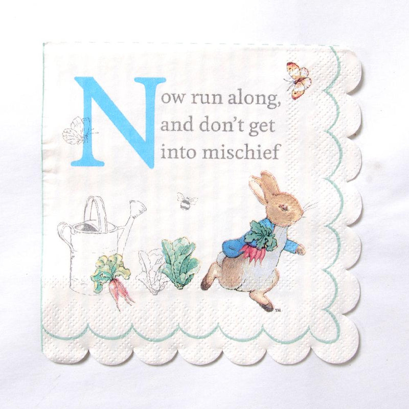 A Scalloped-edge party napkin featuring Peter Rabbit and a phrase from the classic book