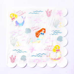A scalloped-edge party napkin featuring mermaid characters and ocean themes