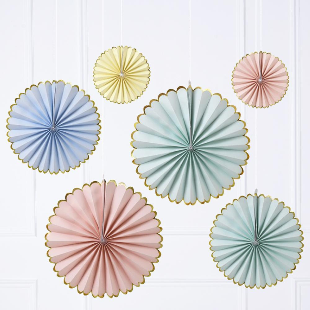 A set of 6 pastel-coloured pinwheel decorations with a gold trim
