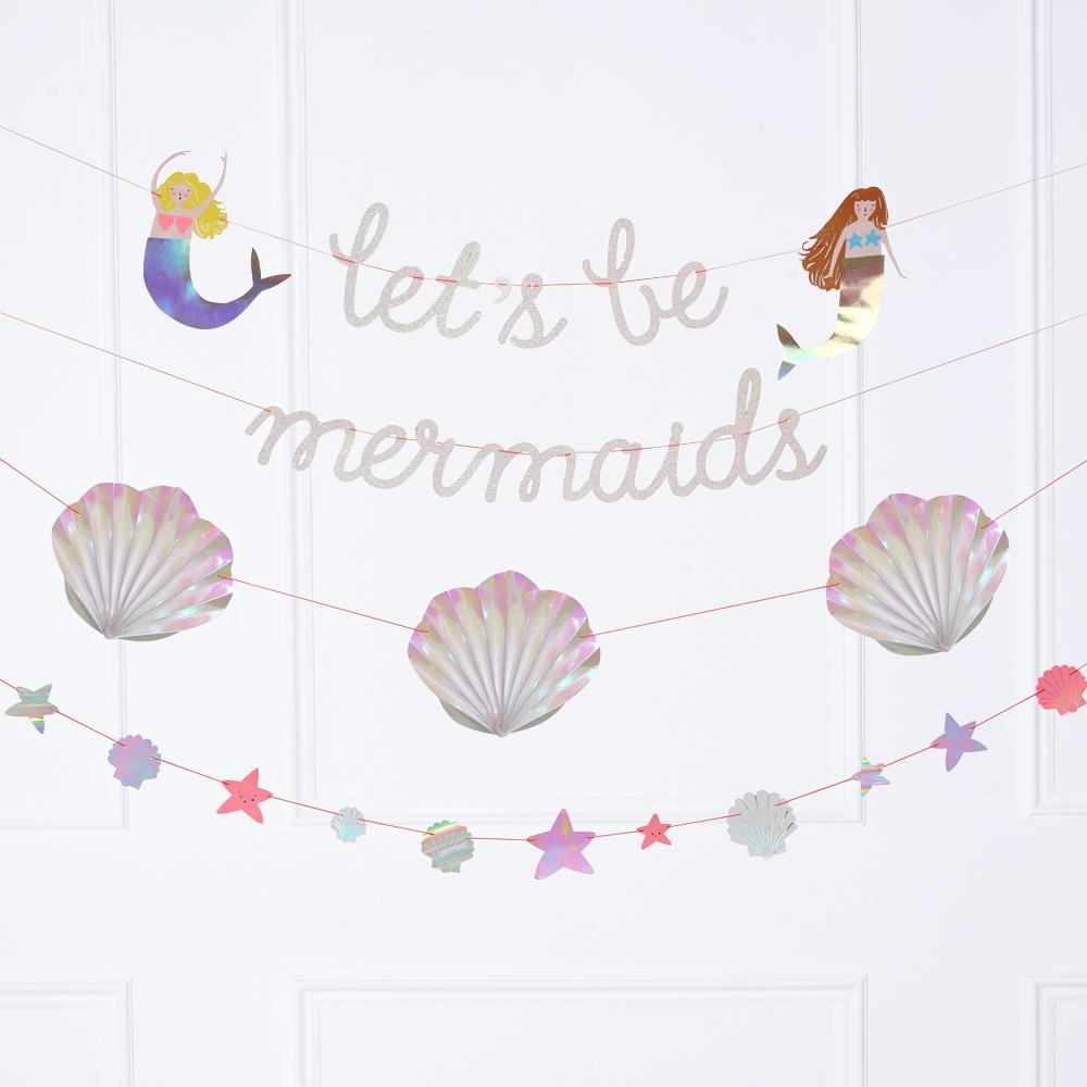 "A mermaid-themed party garland featuring a phrase saying ""Let's Be Mermaids"""