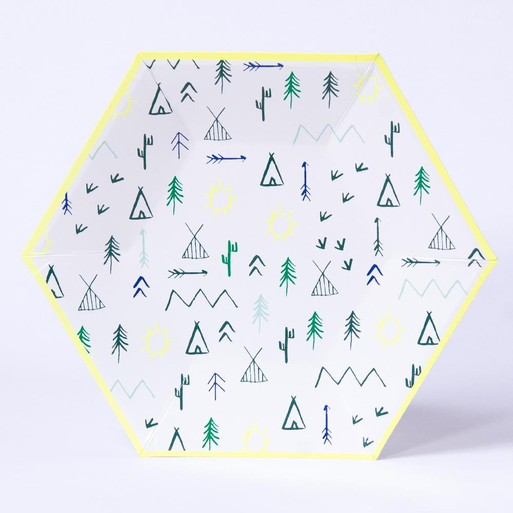 A hexagonal party plate with woodland-themed doodles and a yellow rim