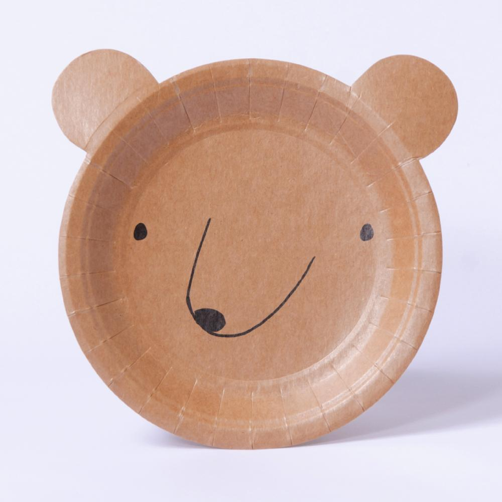 A bear-shaped party plate for a woodland adventure party