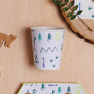 An outdoor woodland-themed party cup on a table