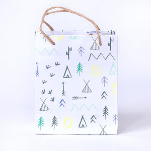 A woodland-themed party bag with a nature-inspired doodle design