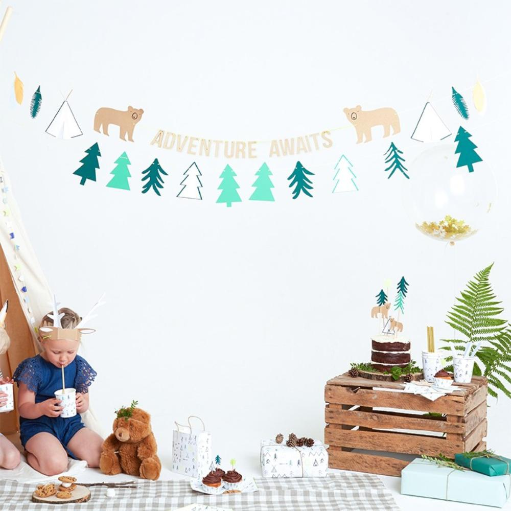 A party garland with a woodland theme and pine tree pennants