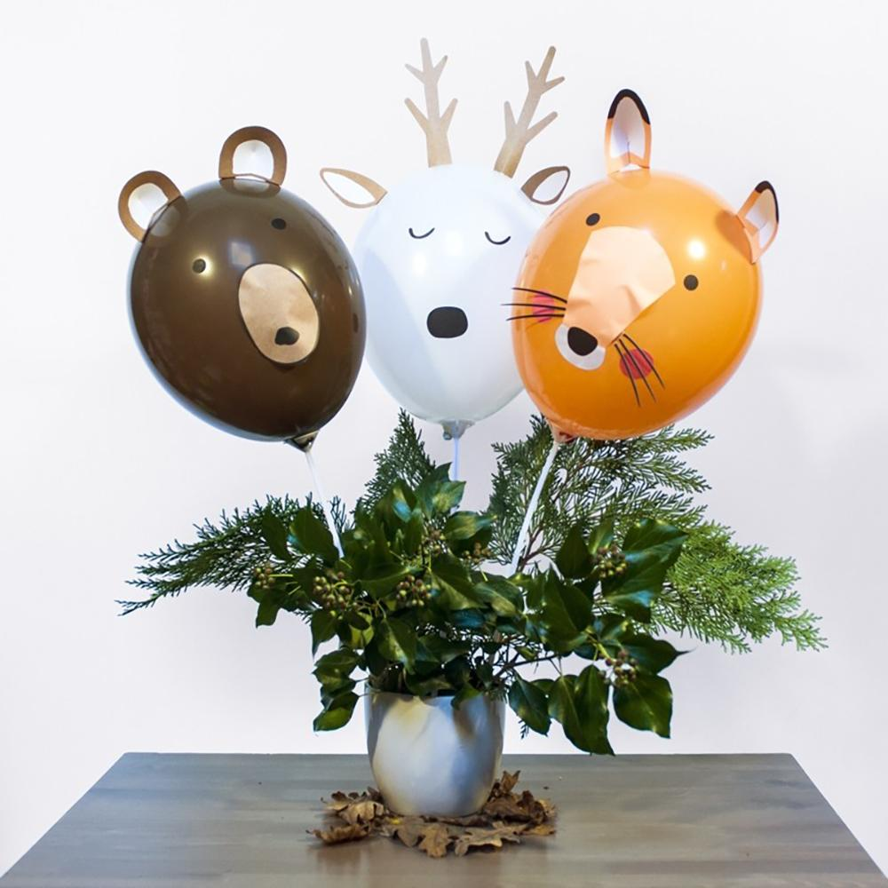 An animal-themed party centrepiece featuring reindeer, fox, and bear balloon-shapes