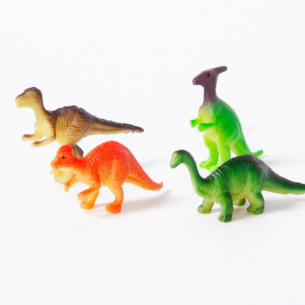 A set of 4 plastic dinosaur figures