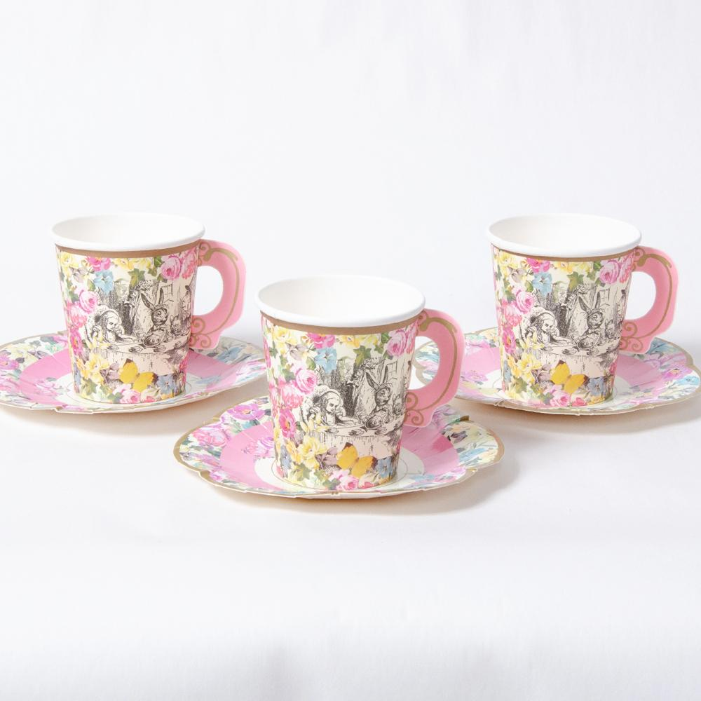 3 Alice in Wonderland-themed party cups and saucers with a floral design