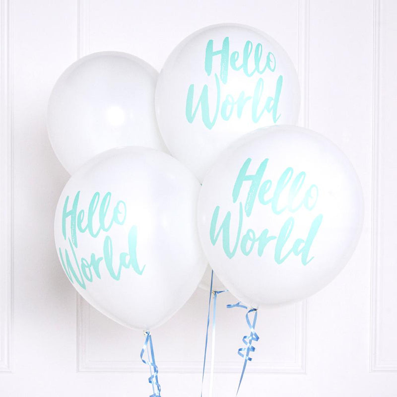A bunch of white latex Baby Shower balloons with a pastel green phrase saying