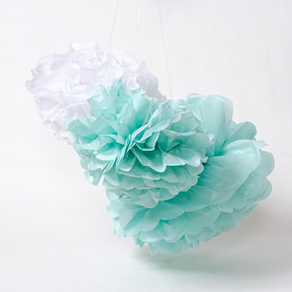 A pastel blue baby shower pom pom decoration with fluffy paper style