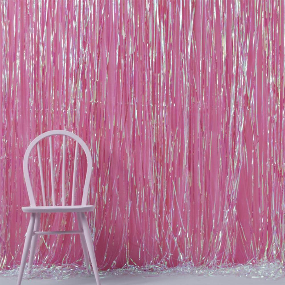 A pink, iridescent fringed door curtain decoration