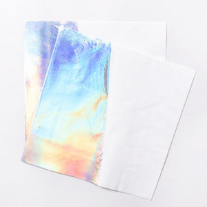 2 party napkins with an iridescent rainbow sheen.