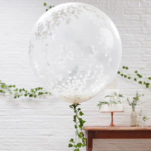 A large clear orb balloon filled with white confetti pieces