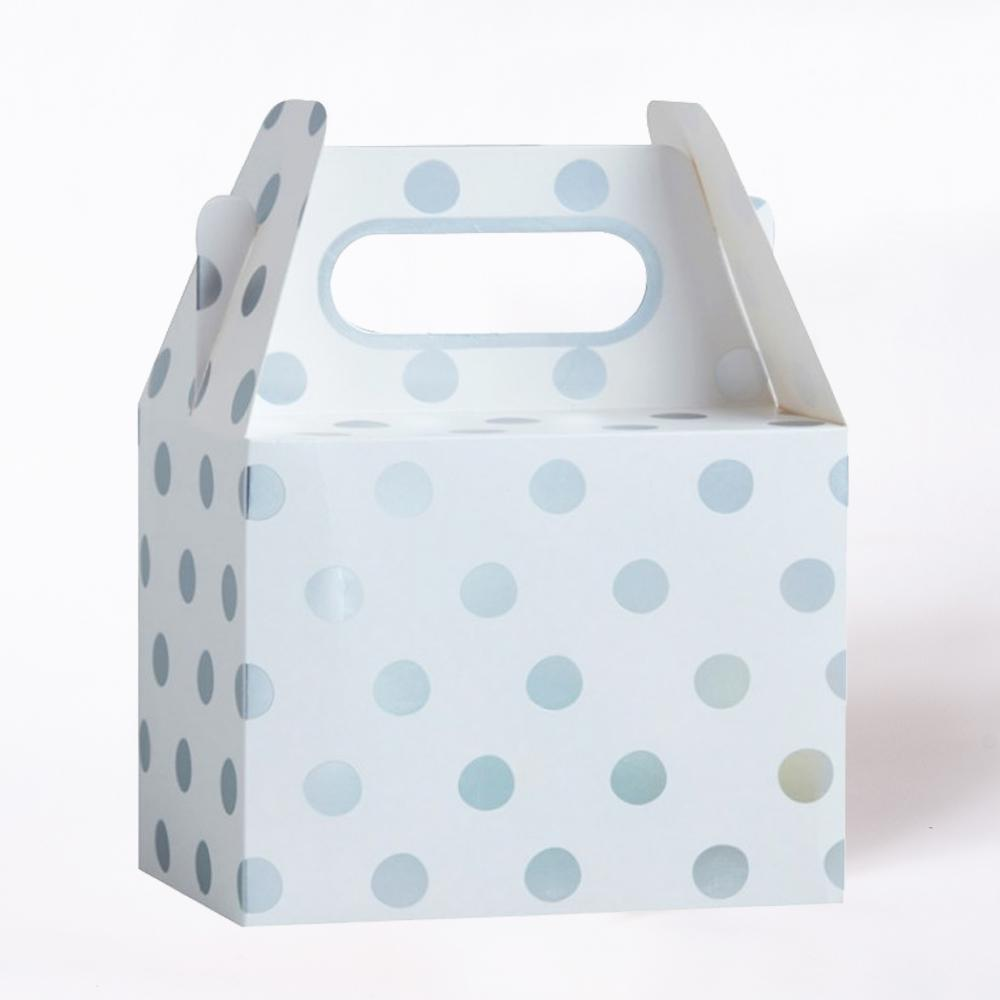 A white paper party box covered in silver foil polkadots