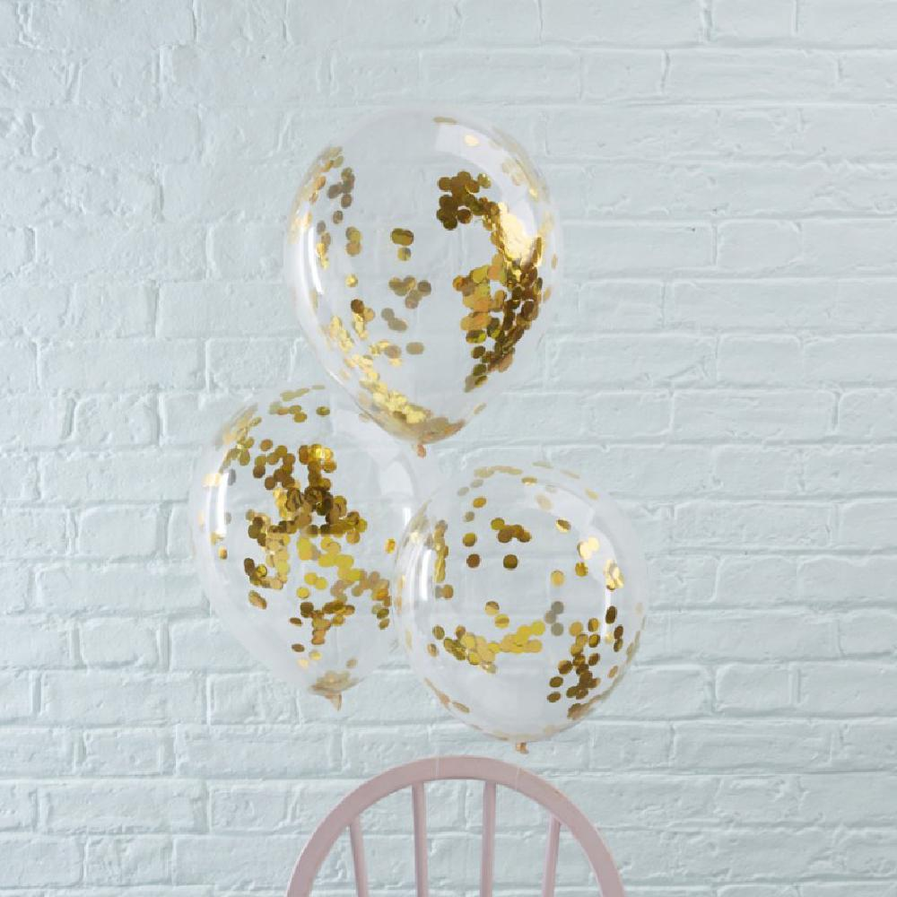 A bunch of 3 clear latex party balloons filled with shiny gold confetti