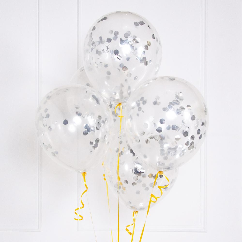 A floating bunch of clear latex party balloons filled with silver confetti