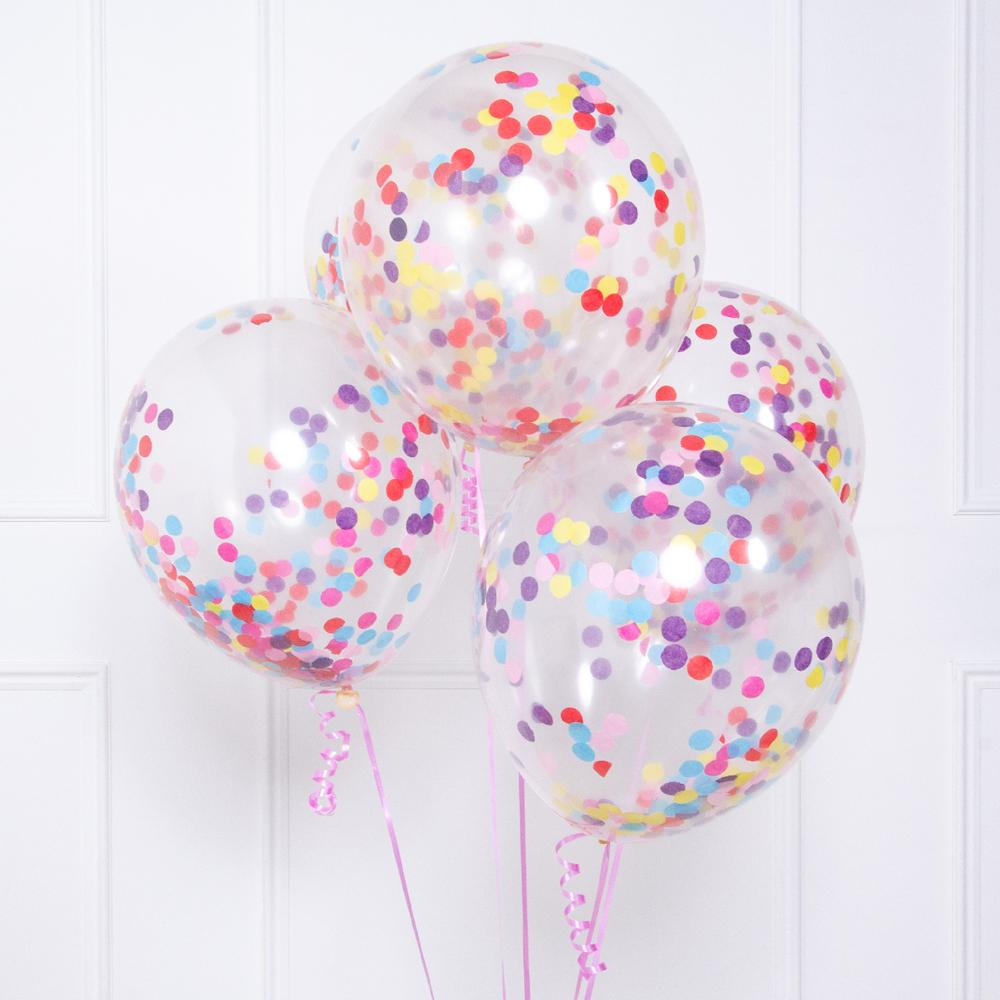 A collection of clear latex party balloons filled with multicoloured confetti