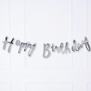 "A silver foiled party bunting saying ""Happy Birthday"""