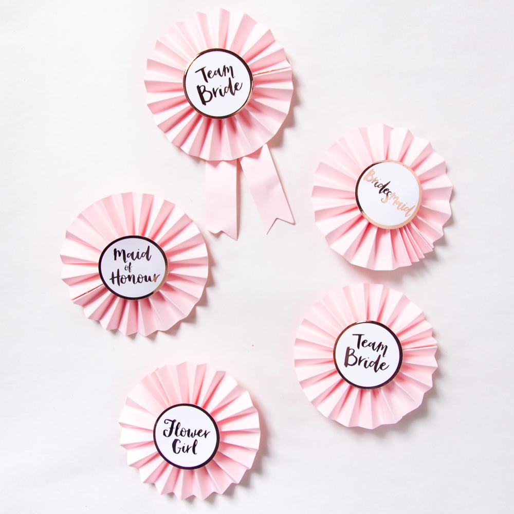 Set of 5 pink hen party roundels laid on white background