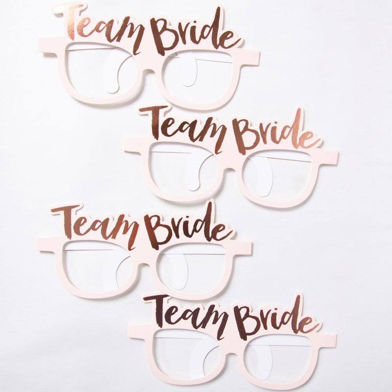 "4 pastel pink hen party glasses with a rose gold foil ""Team Bride"" phrase on top"