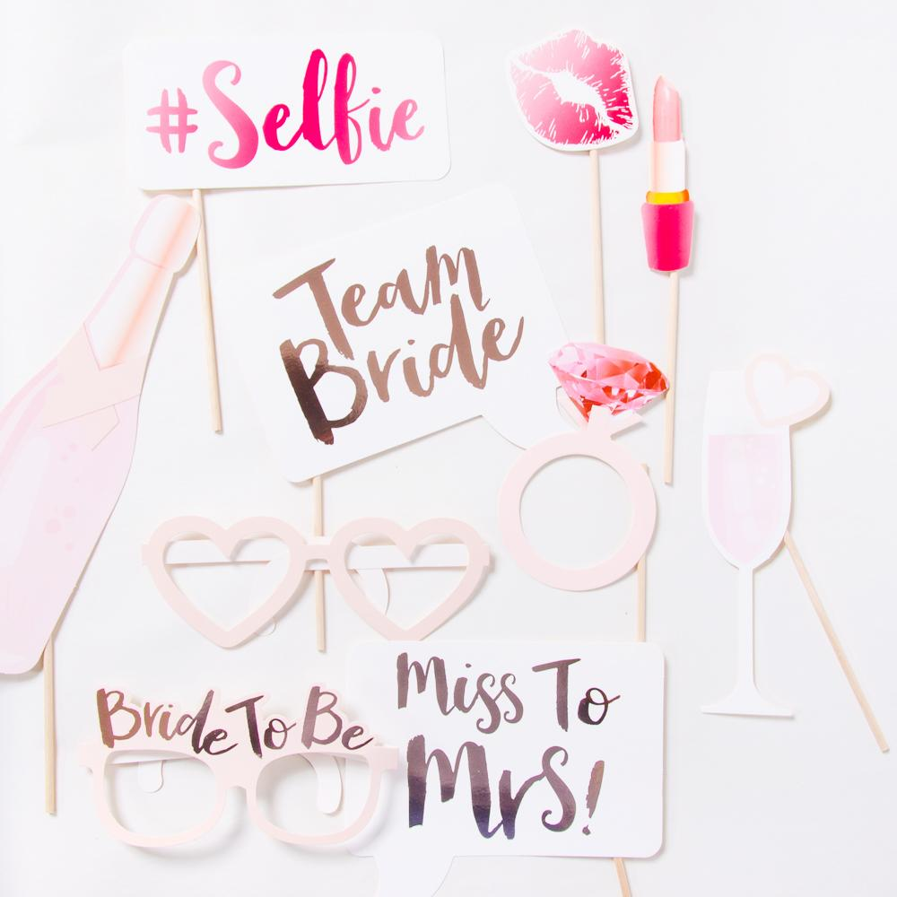 Hen party photo booth props laid out on a flat white background