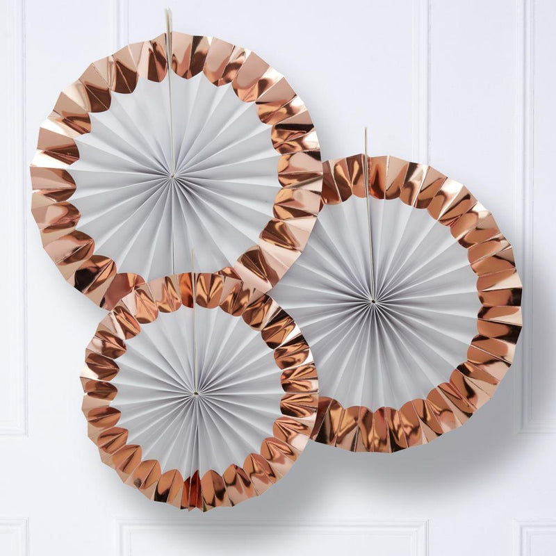 A set of 3 rose gold and white party fan decorations