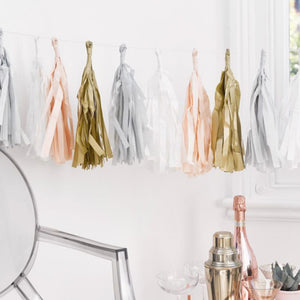 A shiny foil tassel garland with silver, gold, rose gold, and white tassels