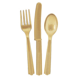 A set of gold plastic cutlery