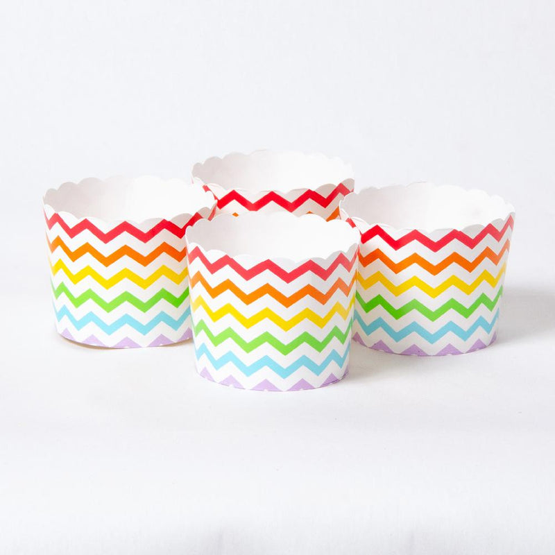 A set of 4 small rainbow-coloured paper party tubs with a scalloped-rim design
