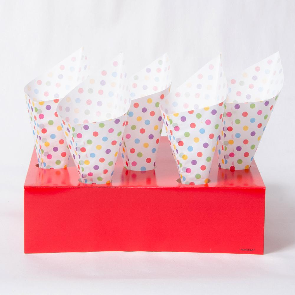 A set of white party snack cones with rainbow polkadots