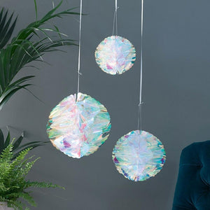 3 hanging honeycomb decorations made from an iridescent foil
