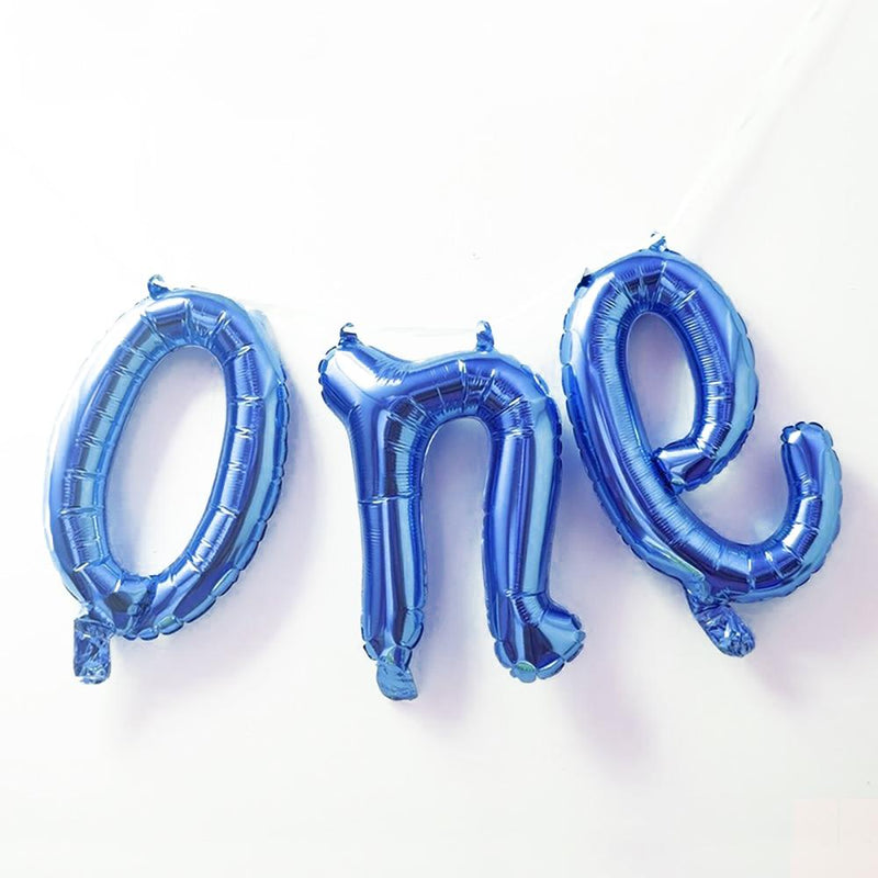 "A blue, 1st birthday balloon banner with the word ""one"""