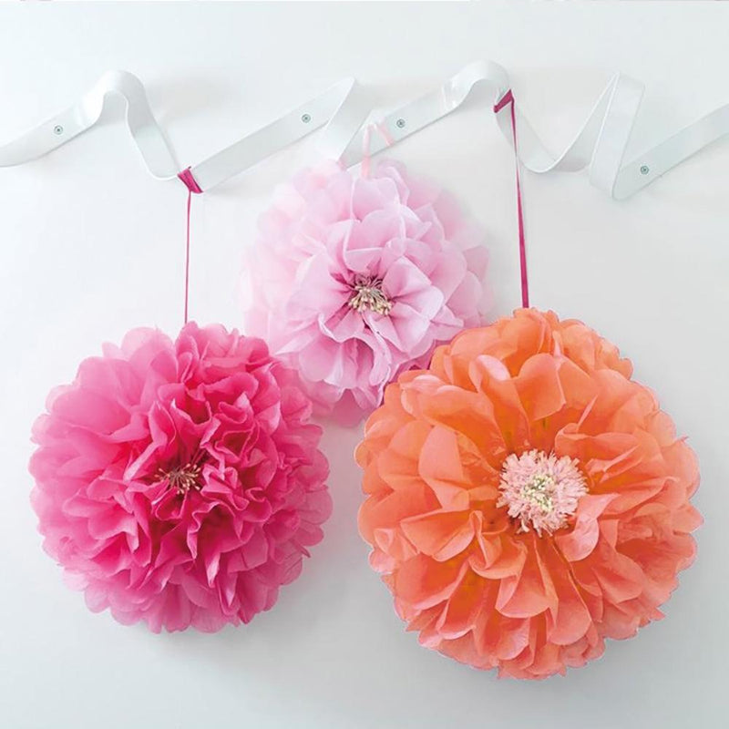 3 paper party pom poms in pink and orange shades