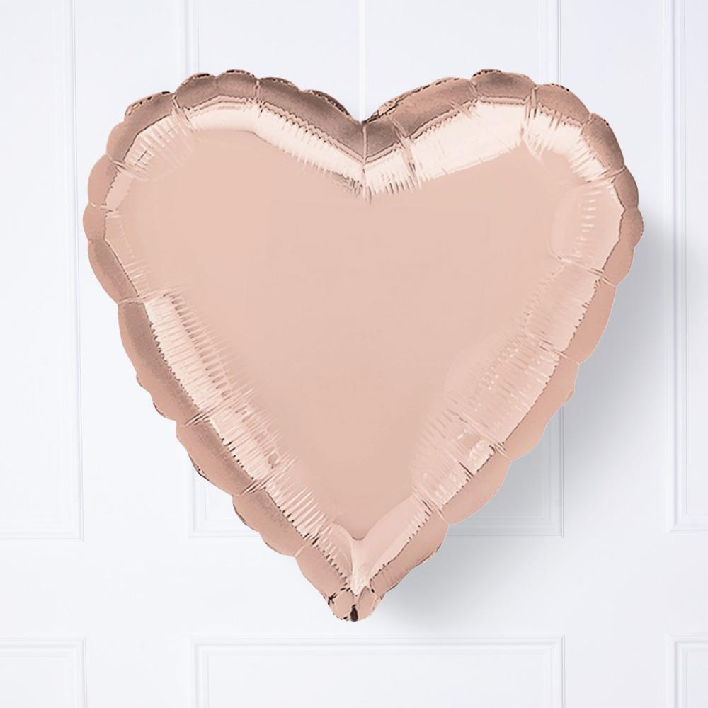 A rose gold foil heart-shaped helium balloon