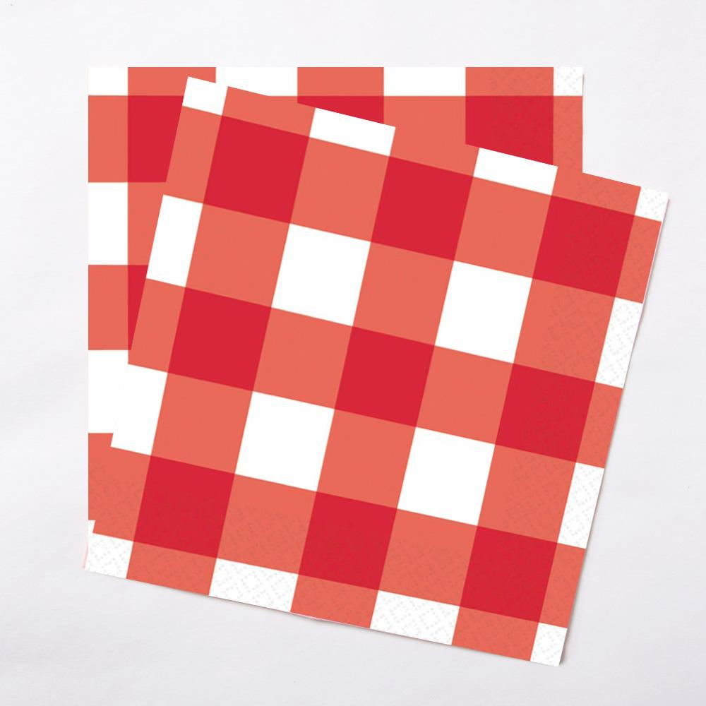 A pair of red gingham style paper party napkins